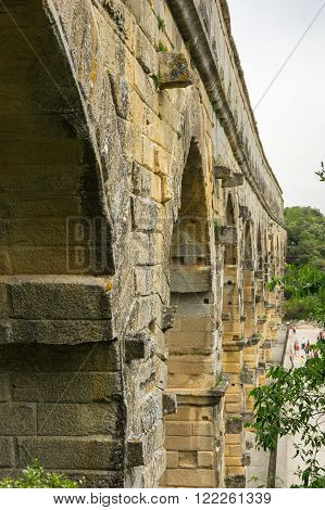 Pont du Gard in Provence France over the Gardon river is an 160 foot high roman aqueduct built to provide water to the city of Nimes from the river Eure near Uzes in the first century A.D.