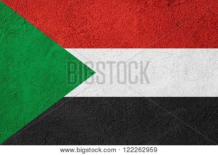 flag of Sudan or Sudanese banner on rough pattern background