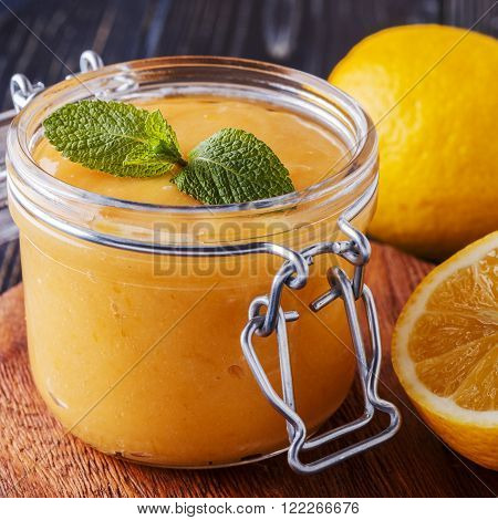 Homemade lemon kurd in a glass jar selective focus.