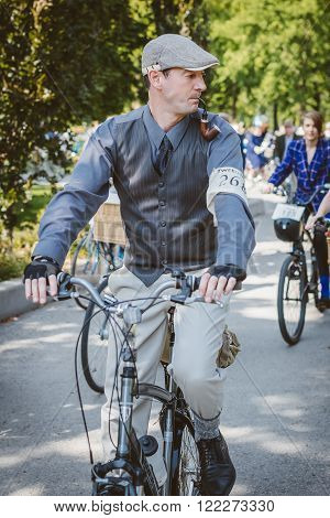 Toronto Canada - September 20 2014: Unidentified participants of Tweed Ride Toronto in vintage style clothes riding on their bicycles. This event is dedicated to the style of old England