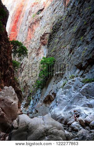 SAKLIKENT CANYON TURKEY - OCTOBER 06 2011: Tourists between the giant rocks and mountain walls