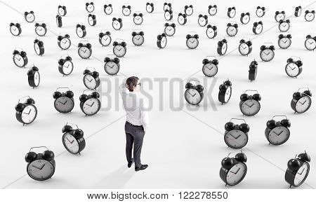 Businessman with hand on head standing on white floor surrounded by question marks. Side view. Concept of solving problems.