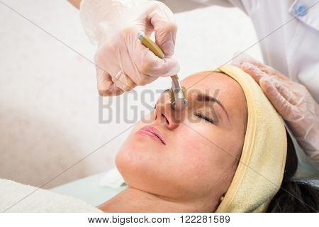 Rejuvenation, revitalization, skin nutrition. The concept of skin care. Cosmetology, cosmetology procedures, cosmetology conducts the procedure. Mask, beauty cream. ** Note: Shallow depth of field