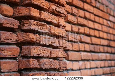 Antique brick, the wall of brick, old building, vintage architecture, breaking bricks, clay brick, brick closeup. ** Note: Shallow depth of field