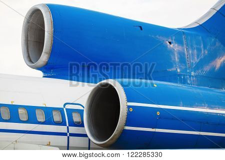 Close-up of a passenger aircraft turbine. Turbines of passenger airliner. The tail of the aircraft.