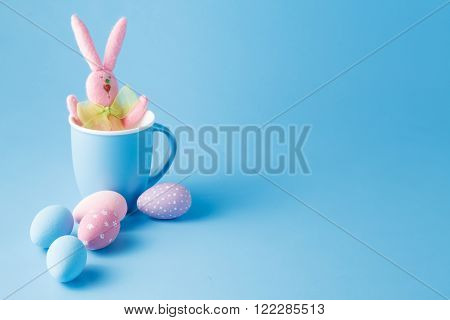 Candy color easter eggs with rabbit over mint