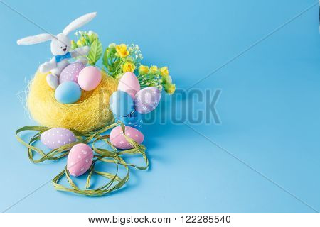Colorde Easter egg decorations over blue background