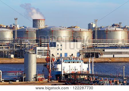 Oil business terminal. The tanker in port.Production, sale, storage and transportation of oil products commercially poster