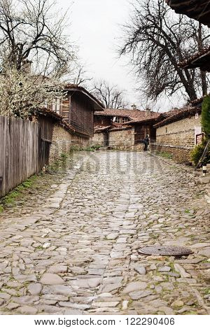 Street with cobble stones of folk museum Zheravna village in Bulgaria. Mountain village.