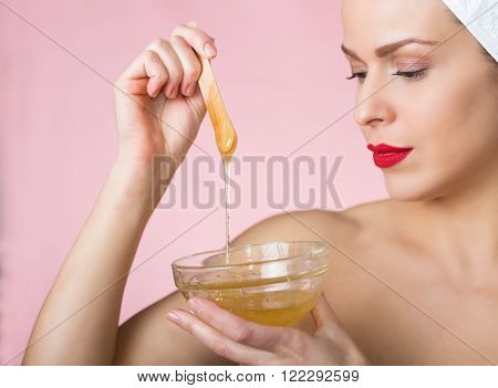 Beautiful woman with hair removing sugar paste