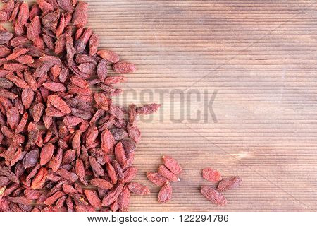Pile Of Red Chinese Wolfberry Fruit With Copy Space
