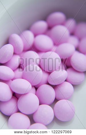 Many pink pills for hyperthyroidism. Isolated. Medicine.