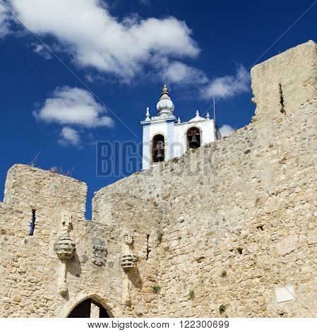 View of the bell tower of the Church of Saint Mary from the portal to the castle of Torres Vedras Portugal