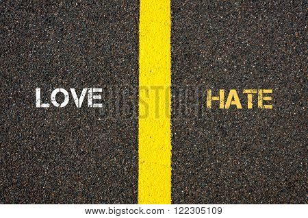 Antonym concept of FRIEND versus ENEMY written over tarmac, road marking yellow paint separating line between words