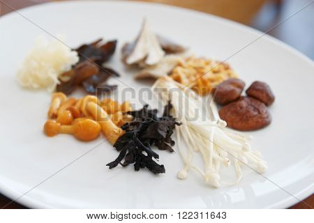 Asian mushrooms on plate, small focus depth