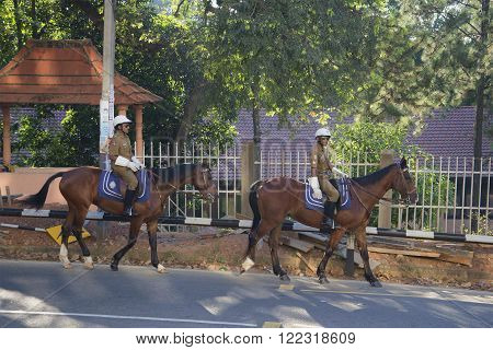 KANDY, SRI LANKA - MARCH 17, 2015: Mounted police on patrol in the streets of Kandy ** Note: Soft Focus at 100%, best at smaller sizes