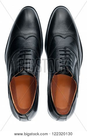 Classic male black leather shoes isolated on a white top view