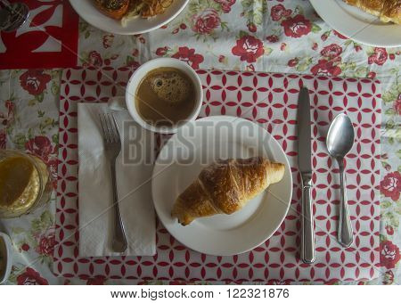 Classic french breakfast retro style - croissant and coffee