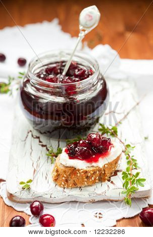 Sweet cranberry jam on toast with soft cheese