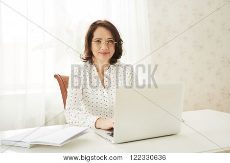 Beautiful Asian Mature Female Using Portable Laptop Computer While Work At Compilation Of Business C