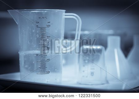 Color image of some plastic recipients in a chemistry lab