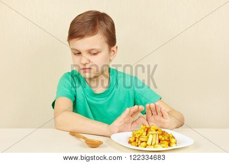 Little cute boy refuses to eat a fries