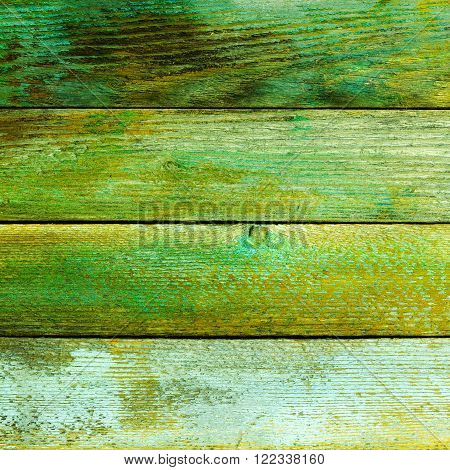 textured background of old wooden barn boards with a green tint. square photo with copy space for text