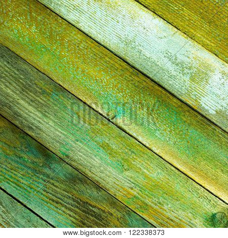 texture of the old wooden barn boards with a green tint. square photo with copy space for text