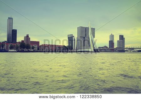 ROTTERDAM THE NETHERLANDS - 18 AUGUST: Rotterdam is a city modern architecture view on Erasmus Bridge and skyline of Rotterdam river Maas in Rotterdam Netherlands on August 182015.