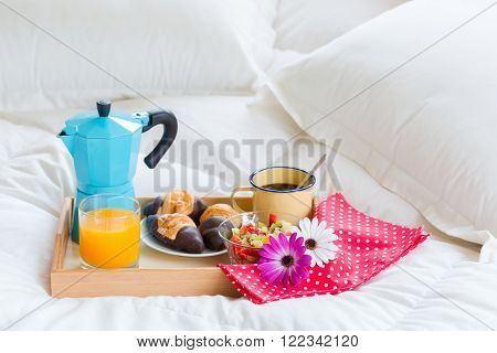 Varied delicious full continental breakfast in bed