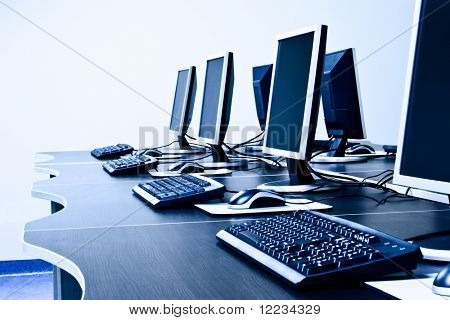 workplace room with computers in row