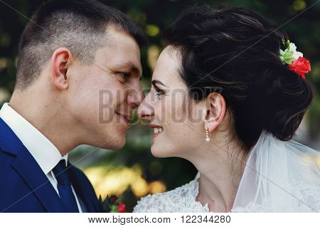 Happy Smiling Husband And Wife Kissing In Park Closeup