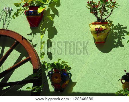 Waggon Wheel And Flowerpots