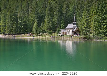 BRAIES (BE), ITALY - JULY 31, 2011: Church on the Braies Lake in Dolomites mountains, Sudtirol, Italy