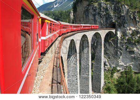 Filisur, Switzerland - 21 july 2007: Bernina Express Train on the famous Landwasser viaduct on the Swiss alps, Unesco world heritage