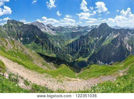 Mountain landscape in the Allgau Alps on the hiking trail to the Laufbacher Eck, above Oberstdorf, Germany. On the left the Schneck, on the right the Hoefats.