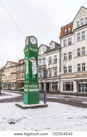Old Clocktower With Advertising For Washing Powder In Snow