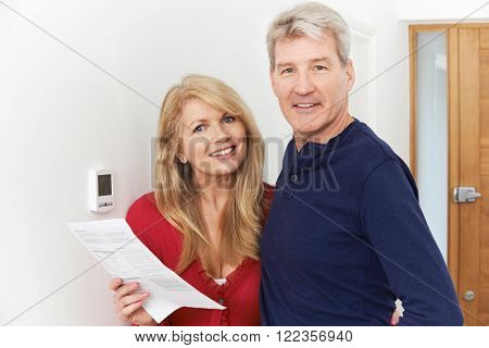 Mature Couple Saving Money On Domestic Heating Bills