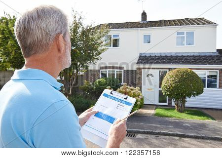 Builder Preparing Estimate For Exterior Home Improvement poster