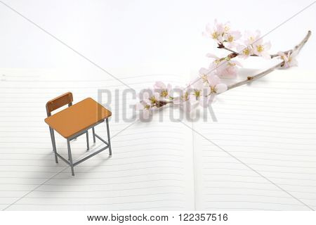 Study desk and cherry blossoms on the notebook.