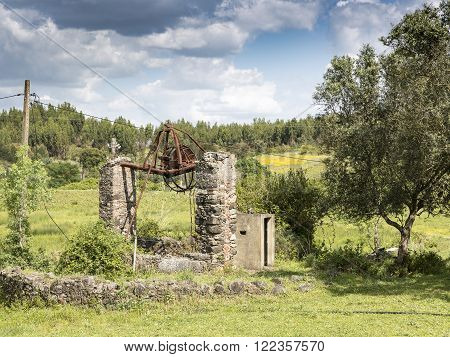 an ancient and rusty watermill in the countryside