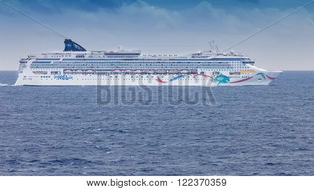 MIAMI, FL - JAN. 22 2011: The Norwegian Dawn cruise ship sails to the Port of Miami on the calm waters of the Atlantic Ocean.