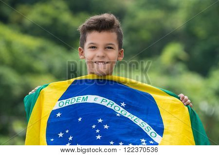 Patriot / Happy child holding the Brazil's flag