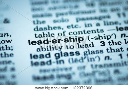 Leadership concept that describes soft skills for leaders and ability to lead in corporate company environment. Word leadership on vocabulary page highlighted and glowing in business blue