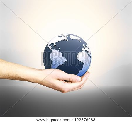 Male hand holding 3D rendered terrestrial globe on grey background