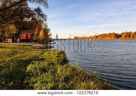 Red house and coastline of river Daugava in Riga, Latvia