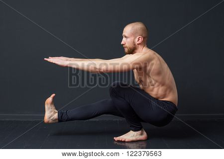 Man Is Doing A  Pistol Exercise