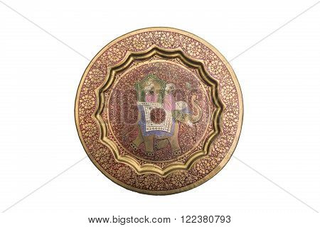 Antic engraved dyed metal plate in oriental style with a pattern of two Indians on an elephant on isolated background