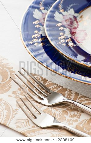 two forks and fine porcelain plates