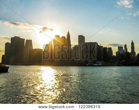 New York city, United States - 30th April, 2008:  spectacular Manhattan skyline with Empire State Building over Hudson River at sunset. Seen from the ferry to Staten Island.